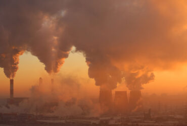 A polluting factory at dawn