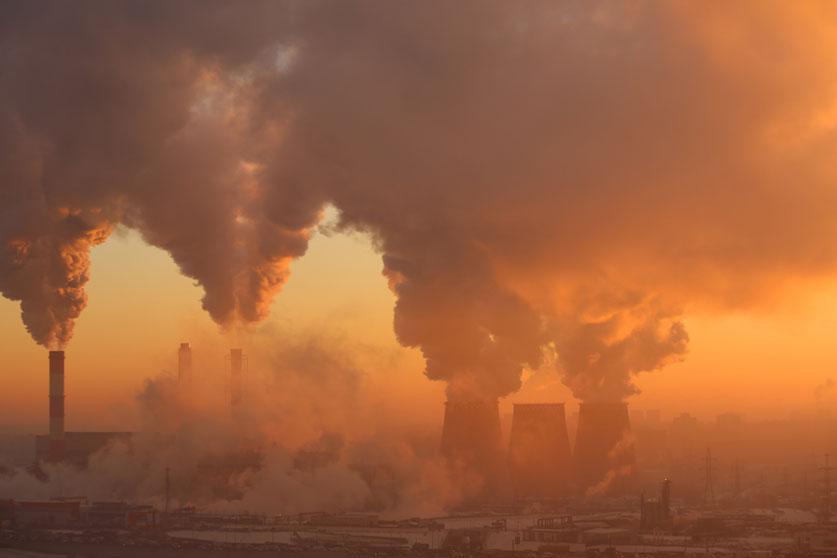 A polluting factory at dawn